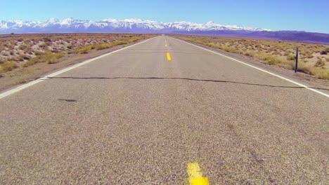 POV-shot-along-a-desert-road-driving-fast-1