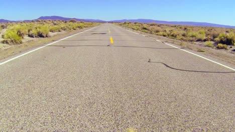 POV-shot-along-a-desert-road-driving-fast-2