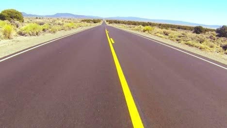 POV-shot-driving-along-a-desert-road-at-a-fast-speed