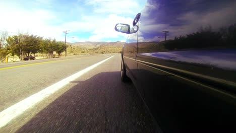 Pov-Shot-Conduciendo-Por-Una-Carretera-Desértica-A-Gran-Velocidad-1