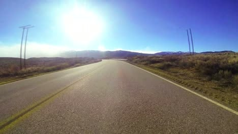 POV-shot-driving-along-a-country-road-at-a-very-fast-speed