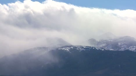 Clouds-blow-over-the-top-of-an-alpine-mountain-range-in-winter