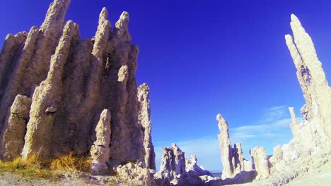 A-traveling-shot-beneath-the-tufa-spires-of-Mono-Lake-in-California-reveal-an-otherworldly-scene