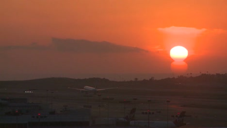 A-plane-takes-off-into-the-sunset-or-sunrise