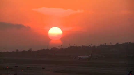A-plane-arrives-at-an-airport-at-sunset-or-sunrise