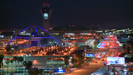 Thousands-of-travelers-arrive-at-Los-Angeles-International-airport-at-night-in-this-time-lapse-shot