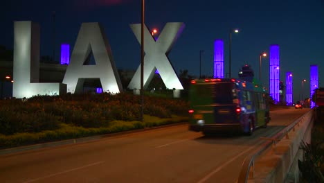 Cars-pass-by-the-LAX-sign-on-their-way-into-Los-Angeles-airport