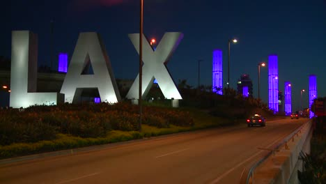 Cars-pass-by-the-LAX-sign-on-their-way-into-Los-Angeles-airport-1