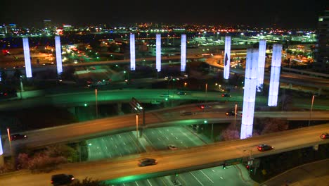 Pan-across-an-overview-of-Los-Angeles-International-airport-at-dusk-with-traffic-arriving