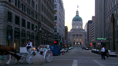 A-horse-drawn-carriage-passes-the-downtown-capital-building-in-Indianapolis-Indiana-1