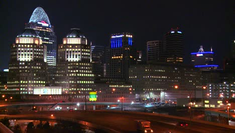 An-establishing-shot-of-Cincinnati-Ohio-at-night-with-freeways-foreground-1