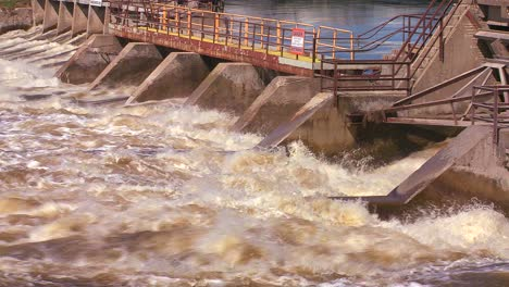 A-dam-handles-fast-flowing-water-in-a-river-1
