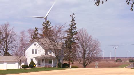 Giant-windmills-in-the-distance-generate-power-behind-farms-in-the-American-midwest-2