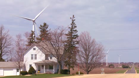 Giant-windmills-in-the-distance-generate-power-behind-farms-in-the-American-midwest-3