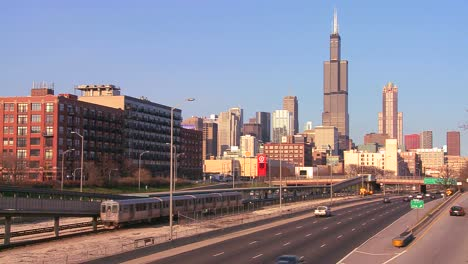 Cars-drive-on-a-freeway-heading-into-Chicago-Illinois-1