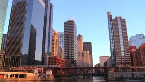 The-El-train-travels-over-a-bridge-in-front-of-the-Chicago-skyline