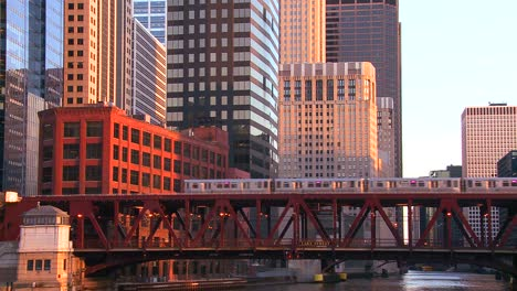 The-El-train-travels-over-a-bridge-in-front-of-the-Chicago-skyline-1