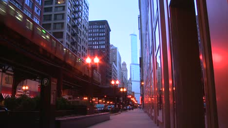 The-El-train-passes-on-an-elevated-platform-at-dusk-in-downtown-Chicago