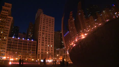 Downtown-Chicago-skyline-at-night-reflected-partly-in-the-Bean-at-Millennium-park