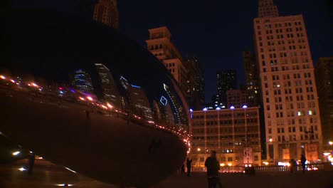 Downtown-Chicago-skyline-at-night-reflected-partly-in-the-Bean-at-Millennium-park-2