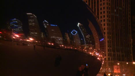 Downtown-Chicago-skyline-at-night-reflected-partly-in-the-Bean-at-Millennium-park-3