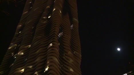 Nighttime-shot-look-up-at-unusual-apartment-building-in-moonlight-Chicago