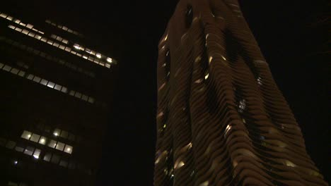 Nighttime-shot-look-up-at-unusual-apartment-building-in-moonlight-Chicago-1