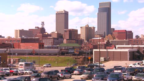 Omaha-Nebraska-skyline-by-day-with-trains-and-trucks-moving-freight-foreground