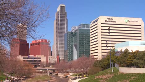 Downtown-Omaha-Nebraska-skyscrapers-rise-above-a-city-park