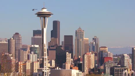 Beautiful-establishing-shot-of-Seattle-Washington-on-a-sunny-day-with-a-helicopter-flying-by