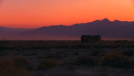 The-sun-sets-behind-an-abandoned-cabin-the-desert-1