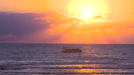 A-fishing-boat-heads-into-the-sunset-on-the-Mediterranean-Sea