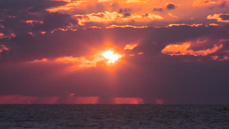 A-beautiful-red-and-orange-sunset-behind-the-ocean