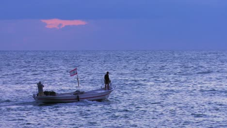 A-fishing-boat-heads-into-the-sunset-on-the-Mediterranean-Sea-1