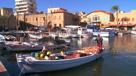 A-traditional-fisherman-works-on-his-net-in-a-harbor-in-Tyre-Lebanon-2