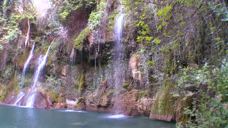 A-tropical-waterfall-flows-into-a-green-pool