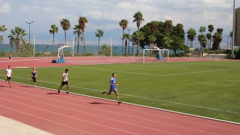 Joggers-run-on-the-athletic-field-at-the-American-University-Of-Beirut-in-Lebanon