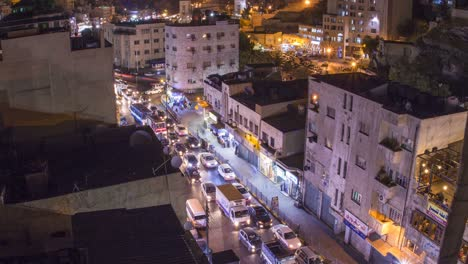 Slow-pull-back-from-high-angle-night-time-lapse-of-downtown-Amman-Jordan