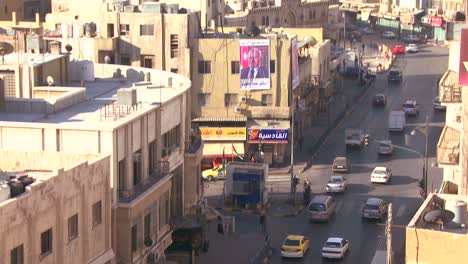 Slow-tilt-up-of-high-angle-morning-skyline-view-of-Amman-Jordan