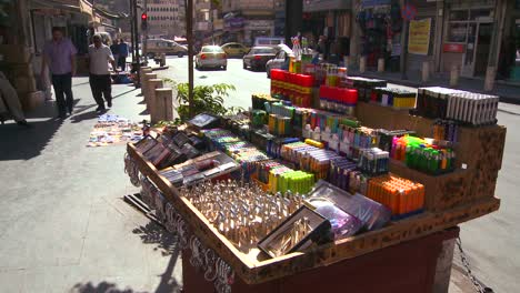 Man-goods-are-for-sale-from-a-street-cart-in-Amman-Jordan