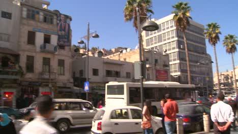 A-portrait-of-Jordans-King-Abdullah-II-hangs-from-a-building-over-the-modern-streets-of-Amman-Jordan
