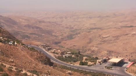 A-wide-angle-shot-of-a-highway-or-road-leading-to-the-Dead-Sea-in-Jordan