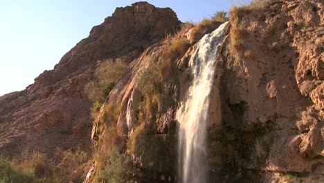 People-bathe-under-a-large-waterfall-of-hot-water-at-a-Dead-Sea-resort-in-Jordan-2