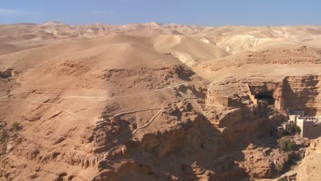 Pan-across-to-the-Christian-monastery-of-St-Georges-in-the-Judean-hills-near-the-Dead-Sea
