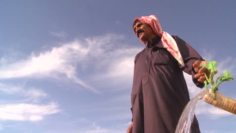 Tilt-up-as-a-Bedouin-provides-precious-water-for-his-flocks-in-the-dry-desert-mountains-of-the-Holy-land