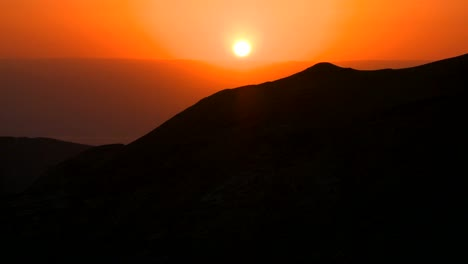 A-beautiful-generic-sunset-behind-a-silhouetted-mountain
