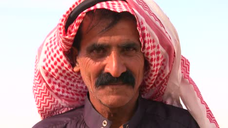 Tilt-up-to-a-close-up-of-the-face-of-a-Bedouin-man-in-Palestine