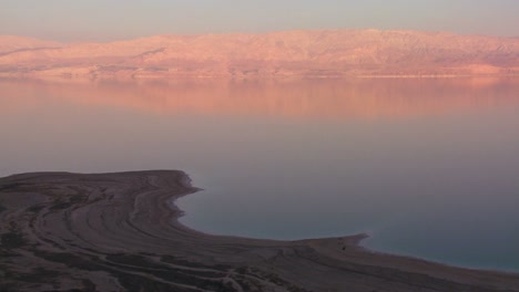 A-high-and-wide-shot-of-the-shoreline-of-the-Dead-Sea-in-Israel-at-dusk