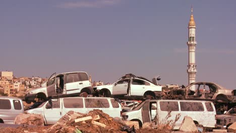 A-junkyard-stands-in-front-of-mosque-in-the-Palestinian-Territories-and-Judean-Hills-of-Israel