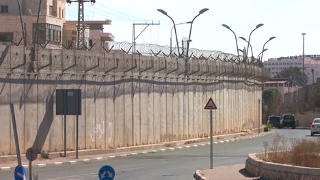 Cars-drive-along-the-new-West-Bank-Barrier-between-Israel-and-the-Palestinian-territories